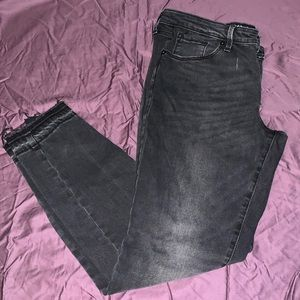 Black vintage wash raw edge skinny jean